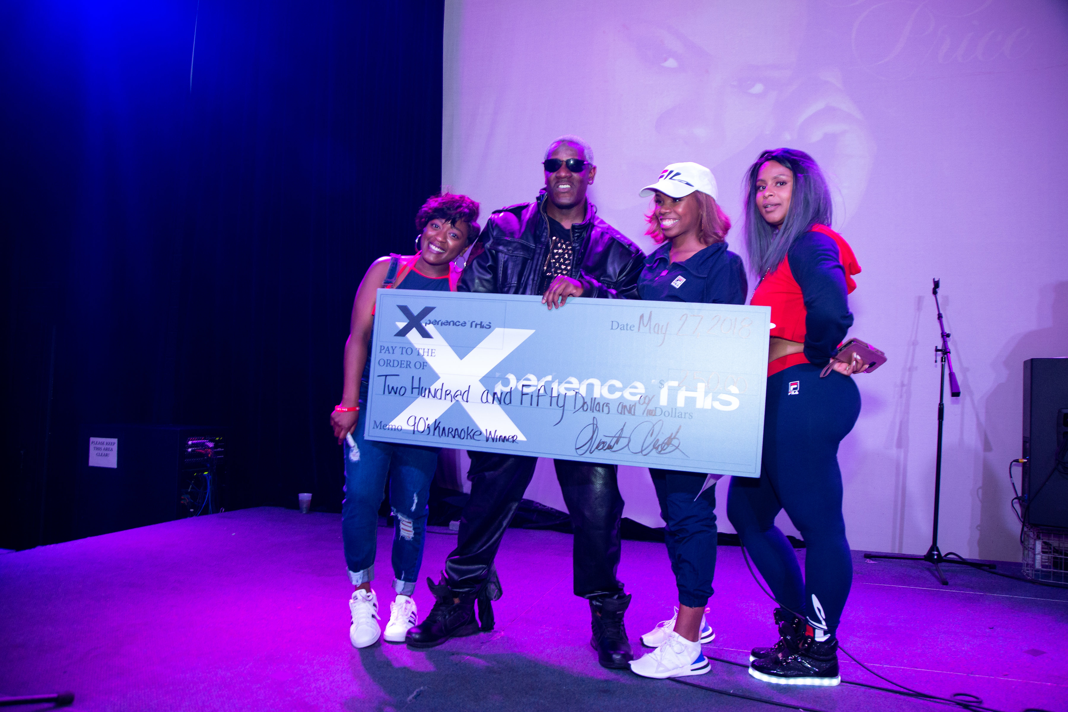 Xperience This poses with winner of check